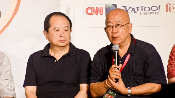 Johnny Chan  (left, with hair), aTV host of Traveler, a popular food programme on China's Travel Channel, and probably one of the most watched food personalities on earth from China.   Danial Wang  (right, holding mic),Singapore's ex-Commissioner of Public Health/Director-General of Public Health.