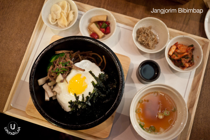 Jangjorim Bibimbap (IDR 85k for Bansang/set; IDR 70k ala carte)  - Bibimbap topped with braised beef in soy sauce, fried egg, seaweed and assorted vegetables in sizzling hot stone bowl.  Overall, this type of bibimbap has a slightly sweet flavor tendency. Yes, more like Japanese dish because of the addition of shredded nori/seaweed. If you don't like spicy Korean sauce this might be the perfect choice for you.