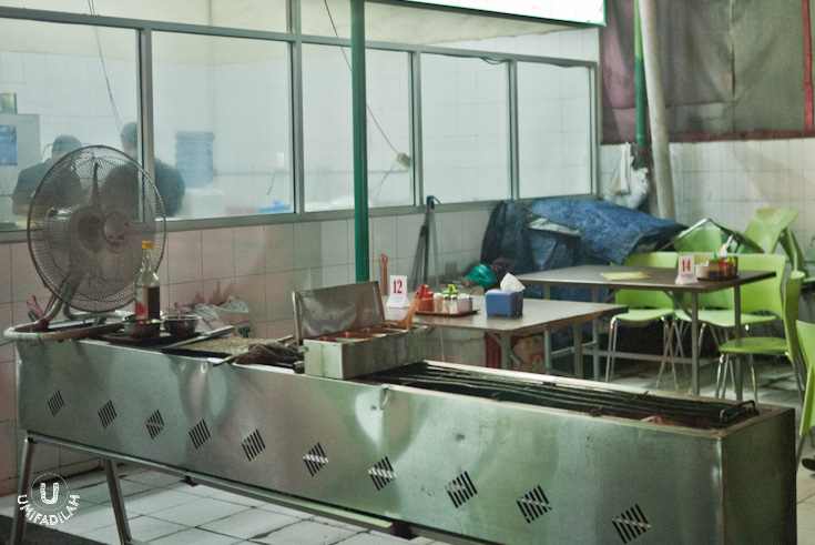The grilling/roasting station is located in front, near the entrance, explaining fragrant lamb aroma pervading the entire area.