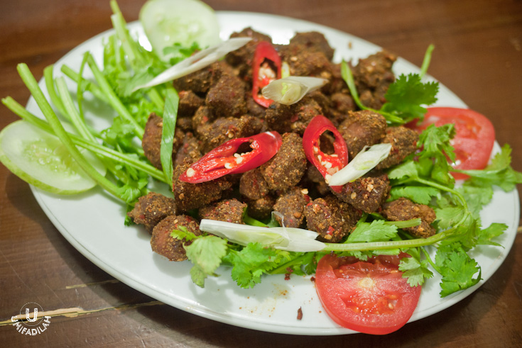 """""""Daging Kambing Ziran"""" / Fried Mutton with Cumin – IDR 80.000.  We were intrigued by its 'masculine' name, and we were right. This is basically mutton seasoned with typical Urghuy strong spices such as cumin seeds, red pepper flakes etc, and it comes with a plateful of cilantro/coriander leaves which really elevates the overall dish. Tasty, but the meat itself weren't as tender as the kebabs earlier."""