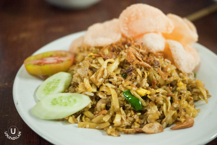 "Nasi Goreng Ayam Jawa (Campur Mie) – IDR 18.000 . It's basically the same as the previous one, except that this dish also incorporate strands of noodle into the fried rice. In Java, we called it  ""Nasi Goreng Magelangan"" . It's for people who could not decide whether to have fried rice or fried noodle, so it's a win-win. For me? Not so much. Their  Lamb Kebuli Fried Rice  wins over anything on the menu!"