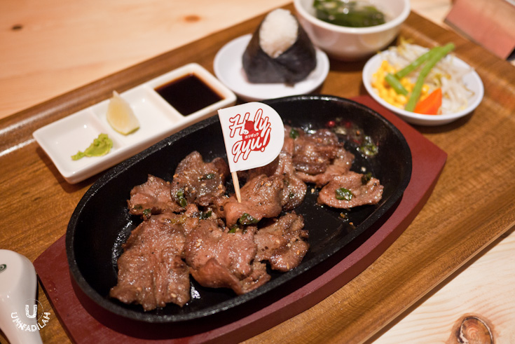 Wagyu Tan – IDR 125k (200gr) / IDR 90k (100gr) . I'm not quite sure if the 'wagyu' term had a specific impact to the cow's body part other than its beef (e.g. tongue, intestinal innards etc), but this Wagyu tan (beef tongue) was tender enough and not chewy at all. It was thinly sliced and seasoned with strong Japanese flavor, I saw sesame and slices of greens (maybe) negi. Served on a hotplate with onigiri, wakame soup, Tsuke Dare sauce with lemon and wasabi, and veggies on the side.  The best way of eating this is to apply a dash of wasabi directly onto the thin slices, then roll'em up before dipping it to the sauce.  Don't forget to hold the onigiri on your other hand!