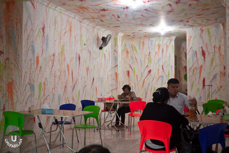 Funky interior; splashed wall-painting.