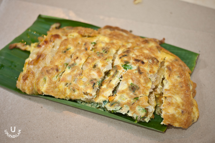Martabak Aceh Daging IDR 19k.  Served with a small bowl of light Acehnese curry for you to dip in. Very tasty!