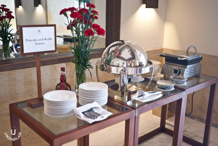 Pancake and Waffle Station  – with Honey butter, maple syrup, whipped cream, vanilla butter. There's also Fruit compote selections and Strawberry + raspberry salad.