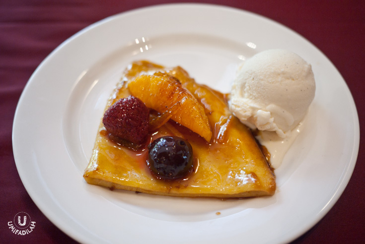 Crepes Suzette  - Thin crepe with caramelized orange flambé, Vanilla ice cream and orange, raspberry and grapes on top. Strong flambe!