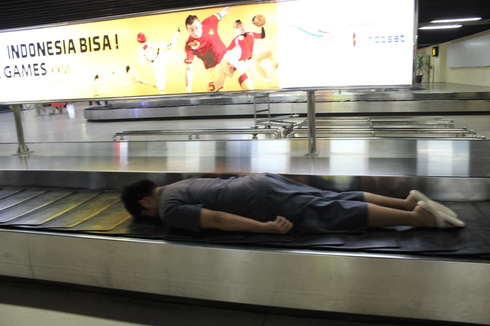 ON AN AIRPORT BAGGAGE'S TRAVELATOR . (which he almost got chased by the airport security...lol)