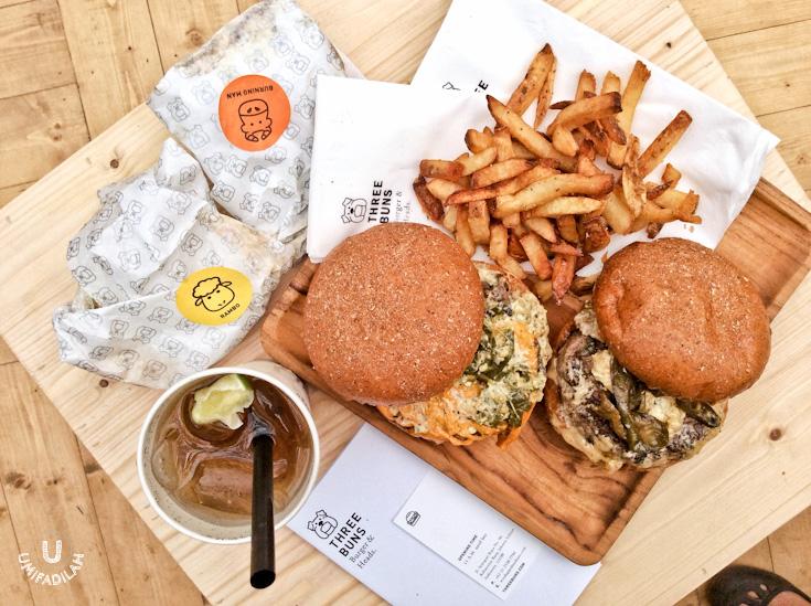 Burger on the left:  BURNING MAN (IDR 110k)  - Prime 150g beef patty, topped withcheese, roasted jalapeño relish, hot ketchup &  dashi  mayo, a Japanese mayonnaise made with shaved bonito and seaweed kombu. Burger on the right:  RAMBO (IDR 120k)  - Superior 150g lamb patty, feta, green chilli, eggplant pickle & cumin aioli.