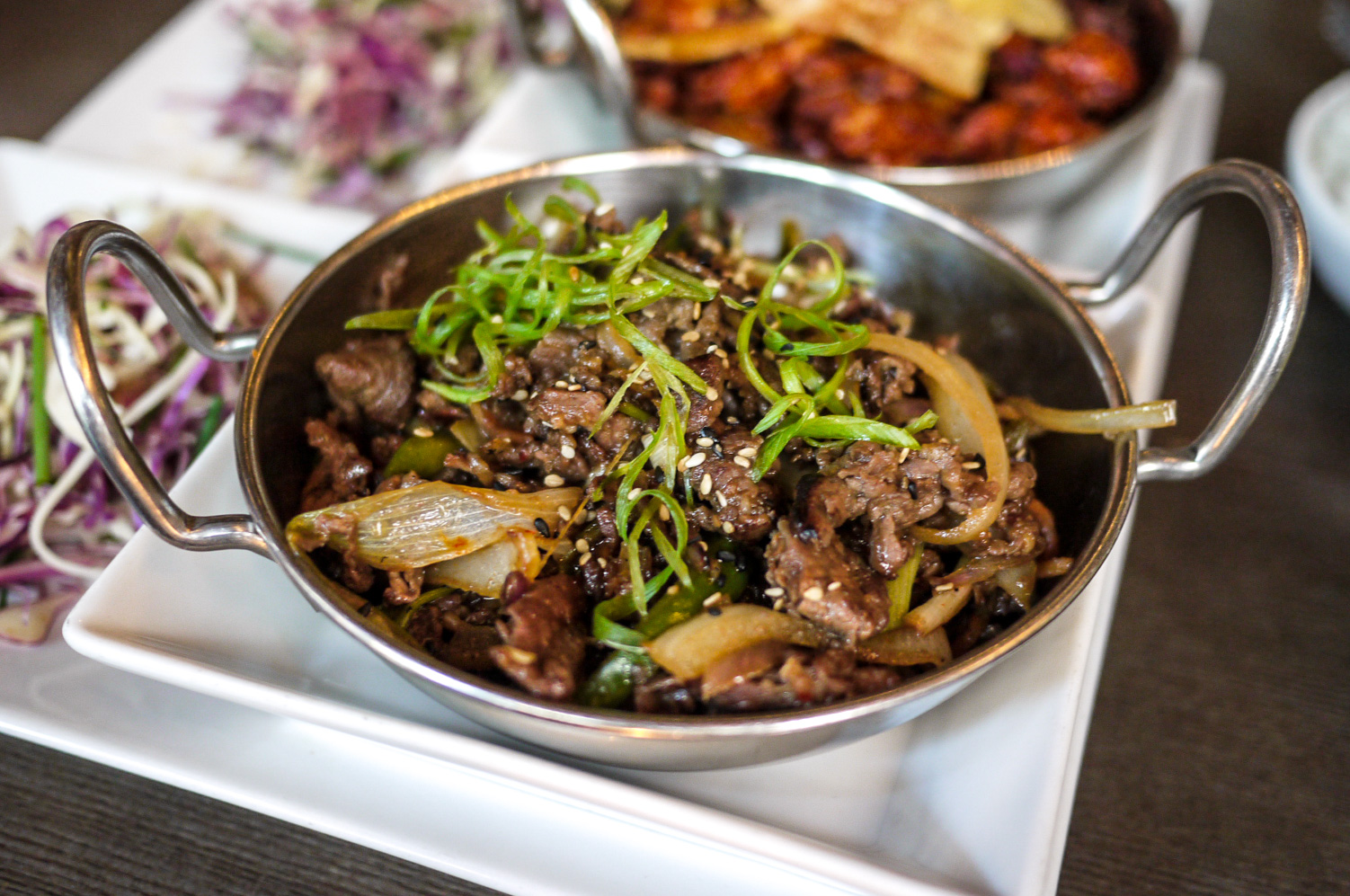 Bulgogi Pot ($14)  - soy-garlic marinated beef ribeye, mushrooms, local greens served with white rice and salad. It was tasty and you just know that the beef quality they're using is just perfect for Korean BBQ. Good for sharing too!