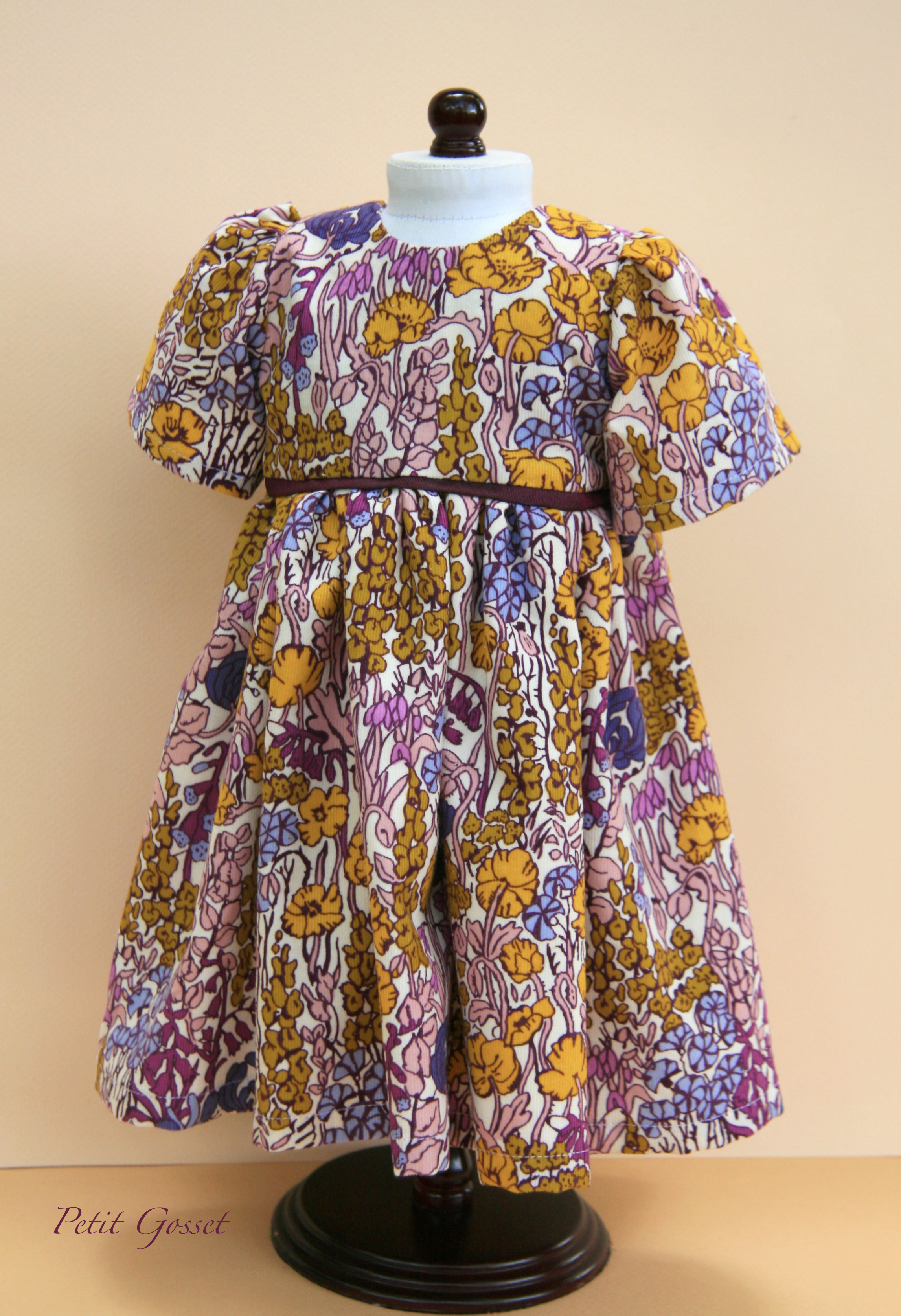 Gorgeous Liberty Print corduroy dress features opening in the back with nickel free snaps