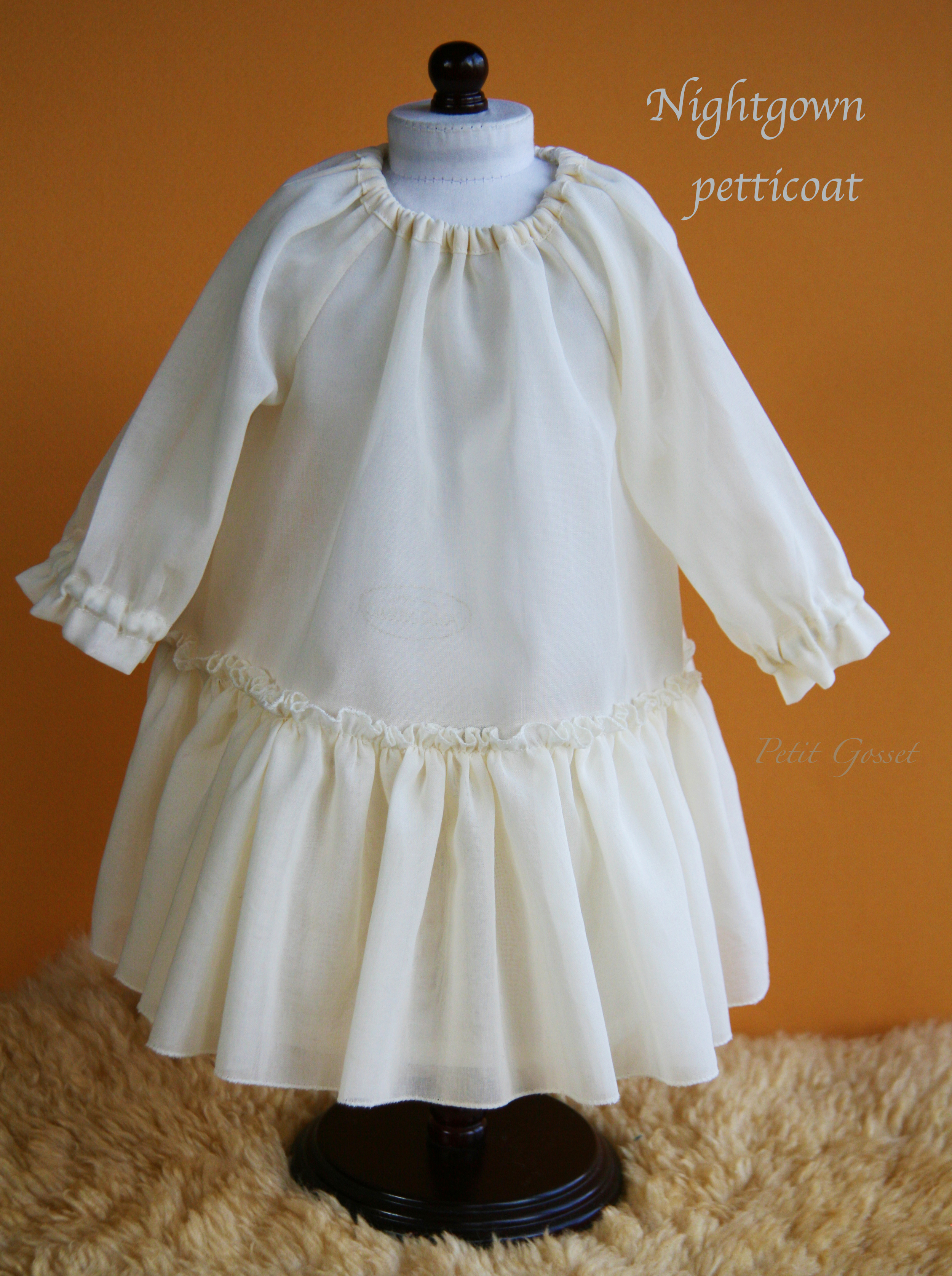"A nightgown petticoat, crafted with Swiss semi-sheer voile. Will fit 18-20"" doll."
