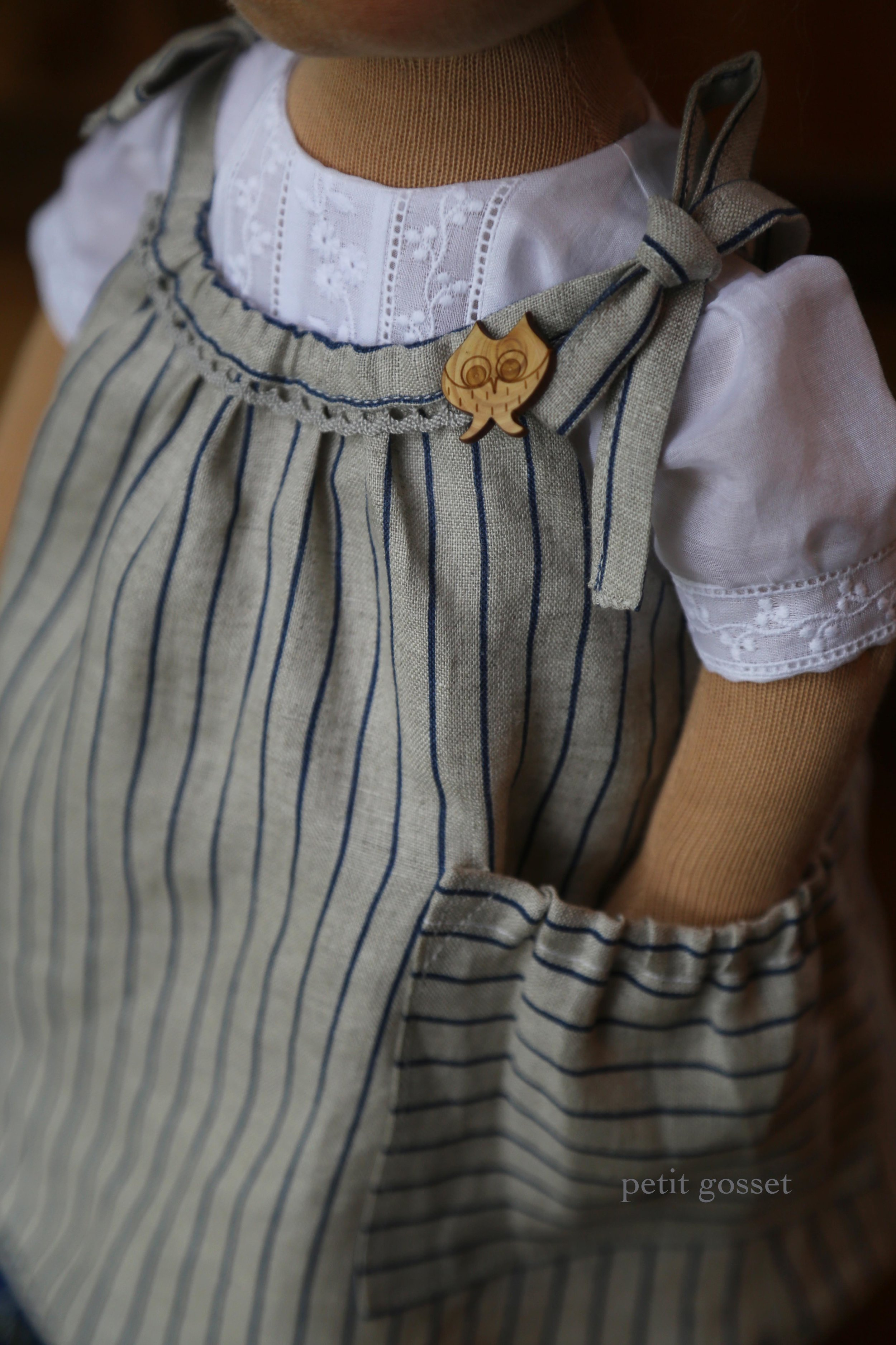 A linen pinafore with a pocket