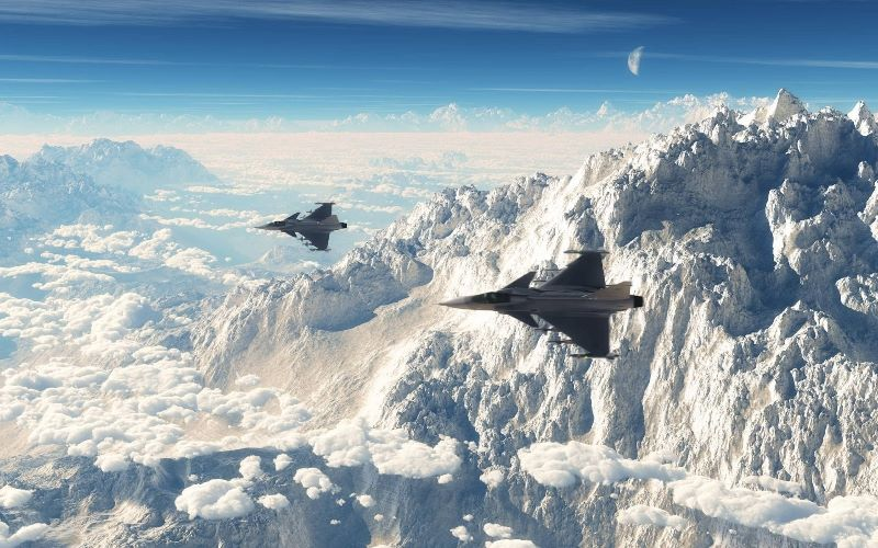 Beautiful view: two Saab JAS 39 Gripens in flight. btw, also in the photo, in the background: the Swiss Alps.