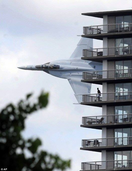 An F-18 pilot, flying past his apartment, sees a stranger in boxer shorts on the balcony. How do you think the pilot will respond?