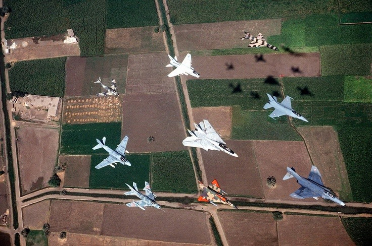 Front clockwise, F-4 Phantom, French Mirage 2000, Mig 19 Farmer , A-6 Intruder, Mig 15, A-7 Corsair, Mig 21 Fishbed, F-16 Falcon & Middle is F-14 Tom Cat.