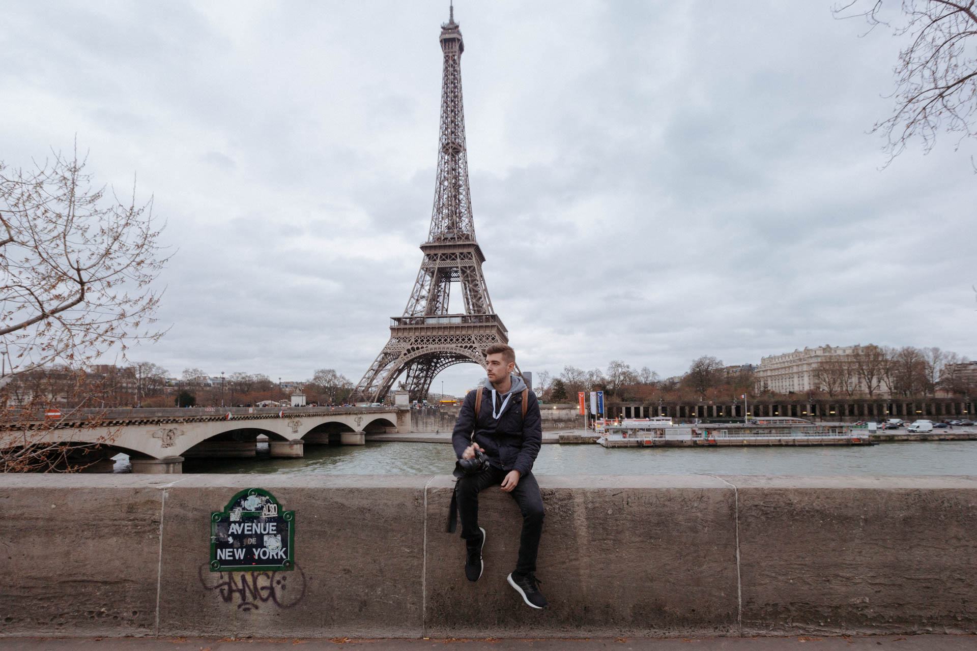 Copy of Eiffel Tower in Paris with Jonathan Grado Sitting in Front of It
