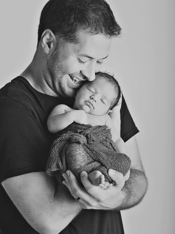 happy dad with newborn daughter