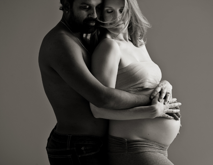 pregnancy and maternity portrait with couple