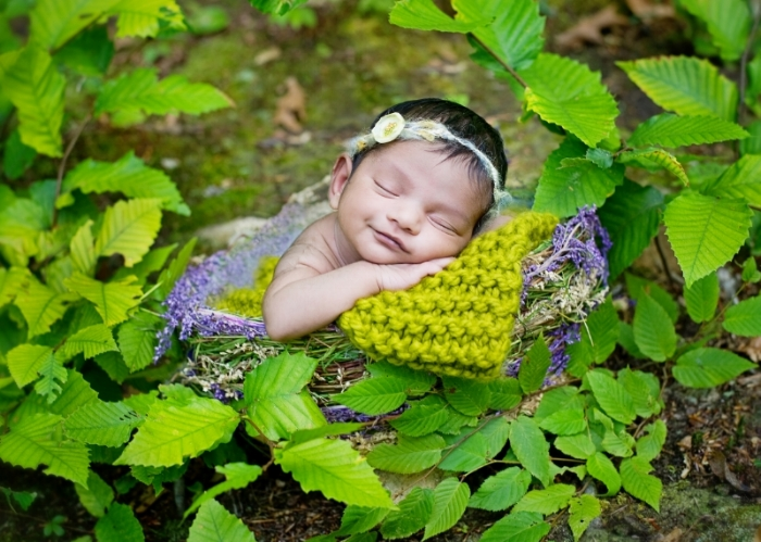 newborn baby girl natural outdoor portrait