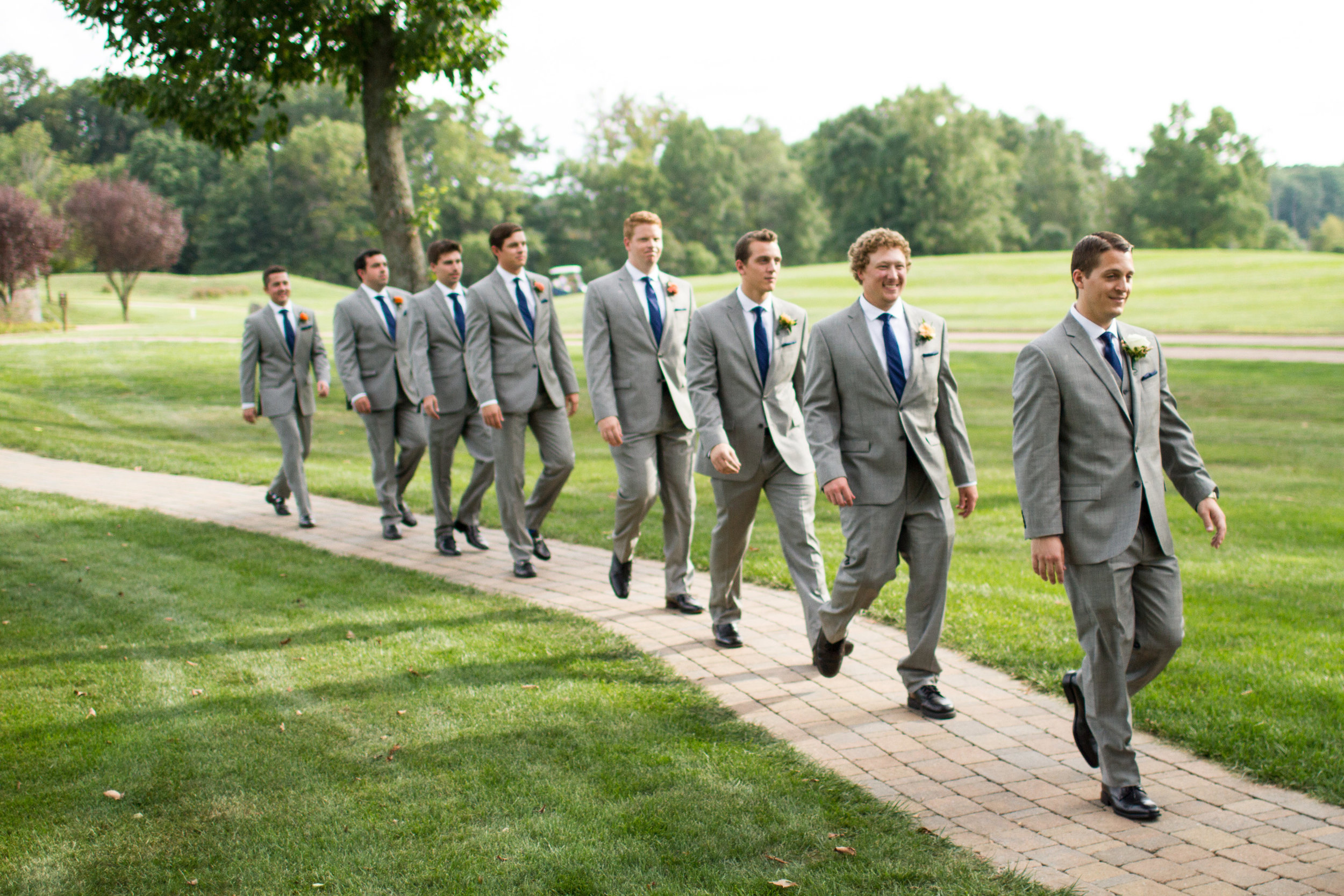 Grey suit and navy ties groomsmen