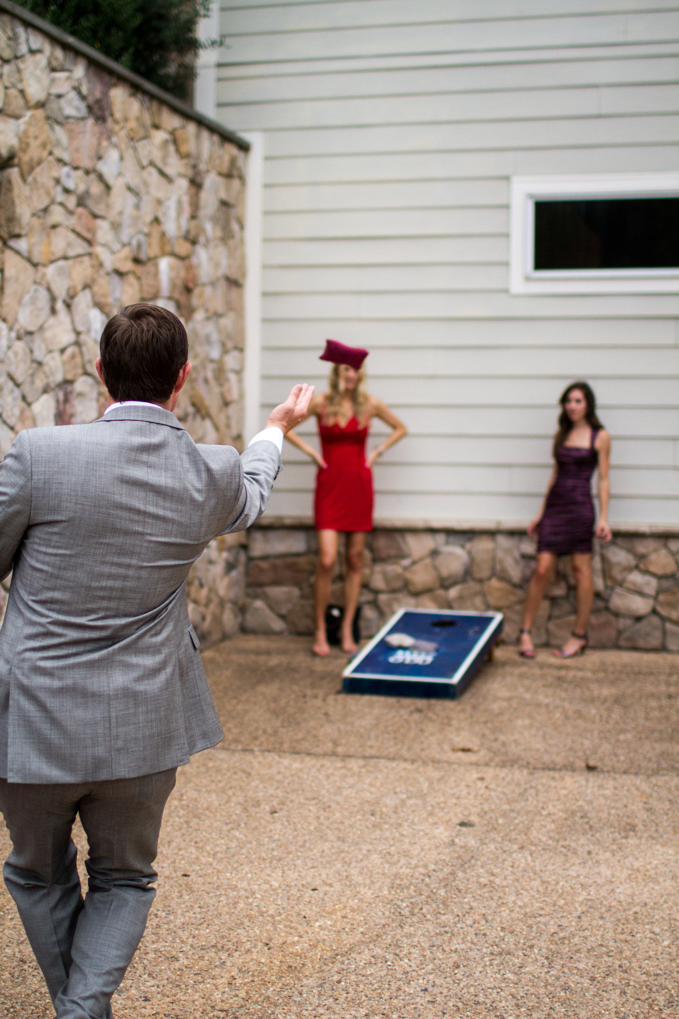 Cocktail hour cornhole game | Bull Run Golf Club wedding