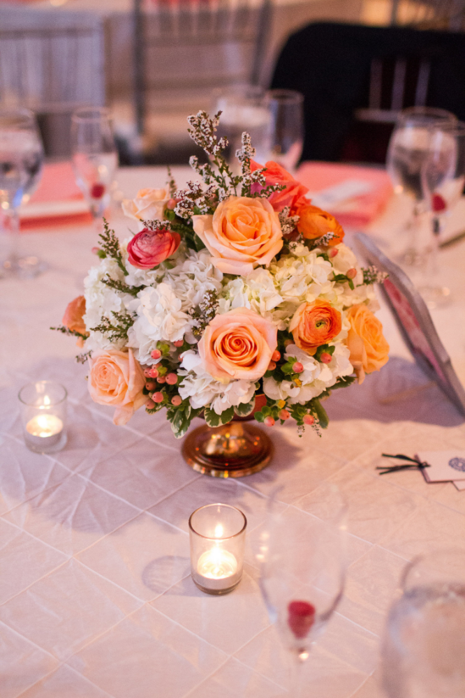 Coral wedding centerpiece | Love is ... Floral Catering
