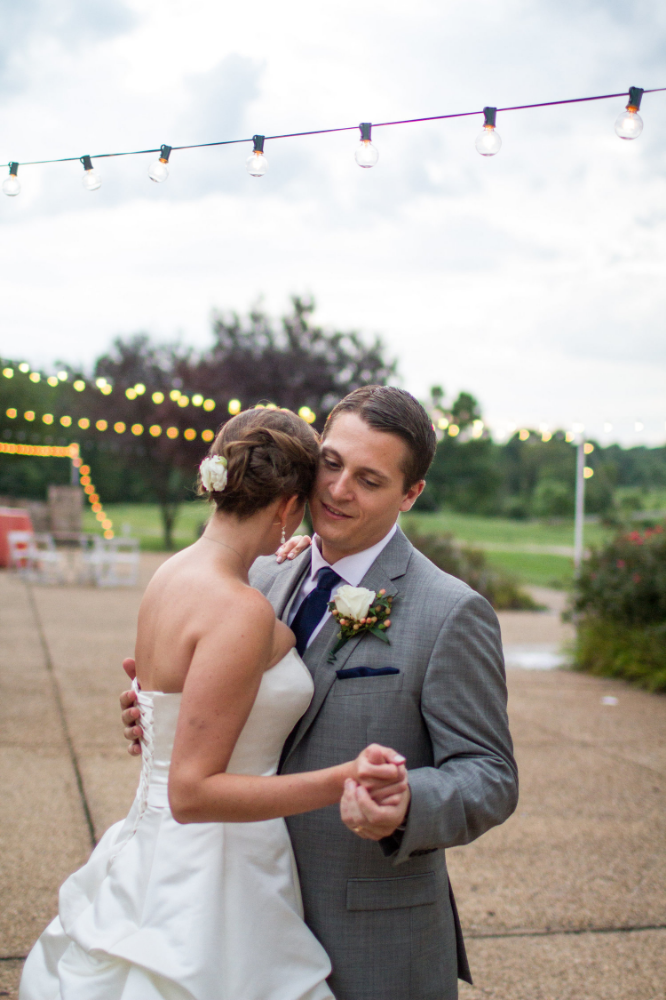 Wedding portraits under cafe lights | Bull Run Golf Club wedding