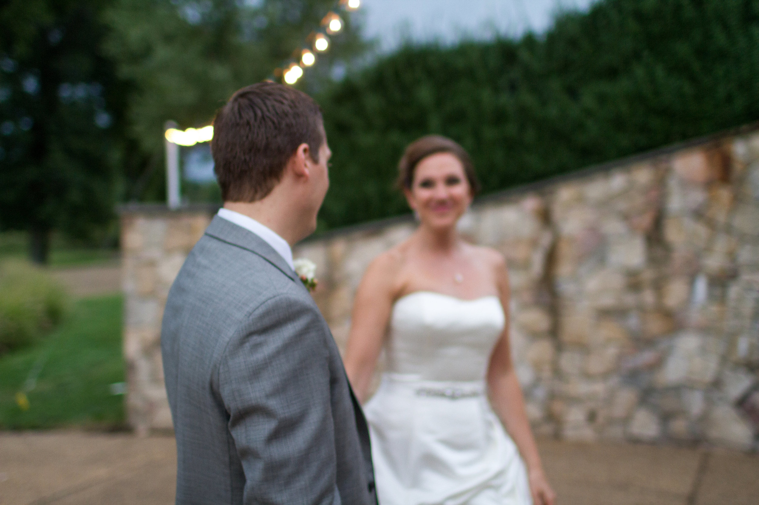 First look portraits under cafe lights | Bull Run Golf Club wedding