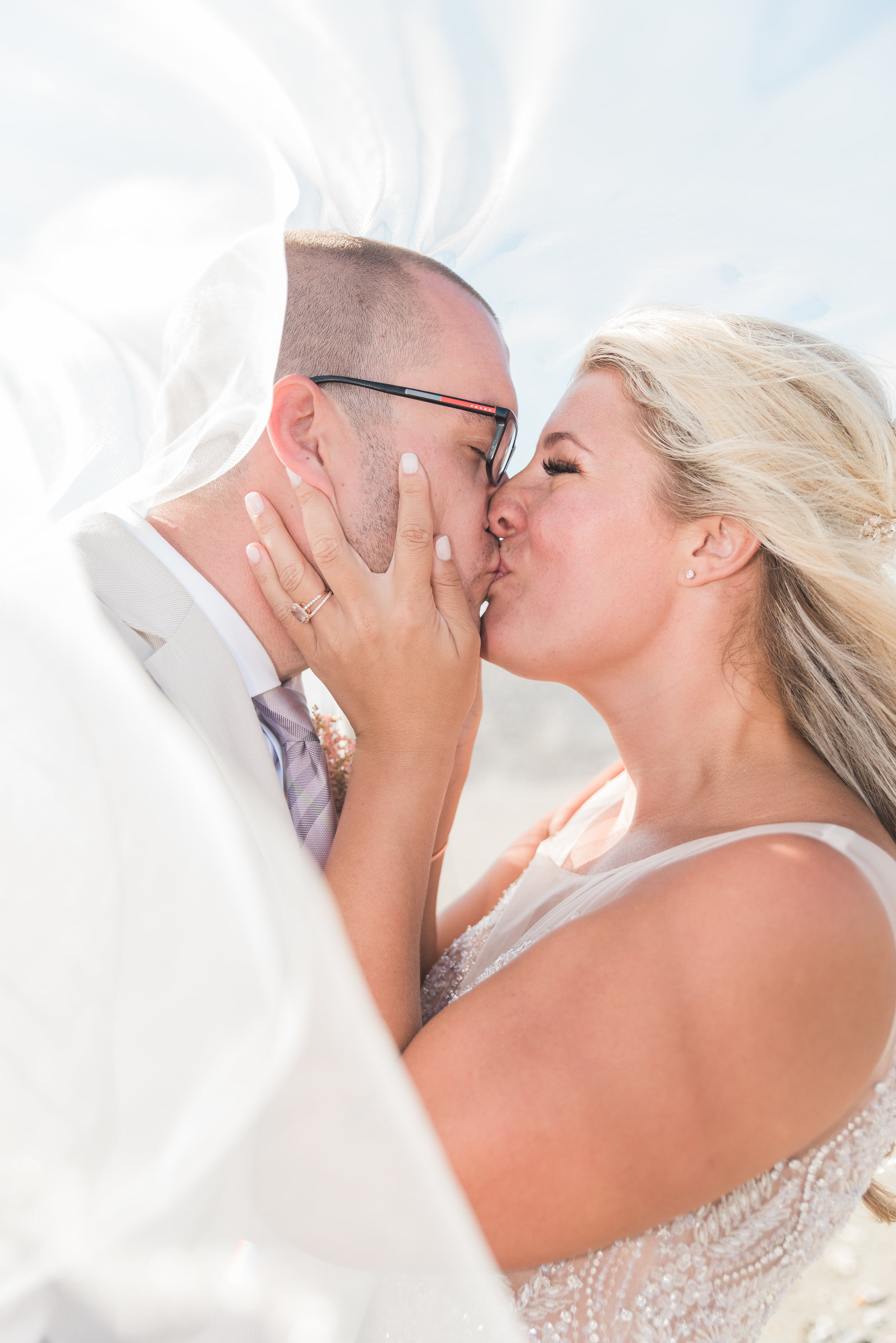 KAYLA + CHRIS - Shanna and Mike made our day magical! They were energetic, professional, easy to work with, and made us feel so comfortable and confident on our wedding day. Shanna trucked through the beach and on rocks with a broken foot to capture unforgettable photos! Every time there was a moment I hoped was being captured, Shanna and Mike were already there. We just received our photos and felt like we got to relive all of the magical moments of our day. My husband and I trusted them completely and are so happy with how they worked their magic!