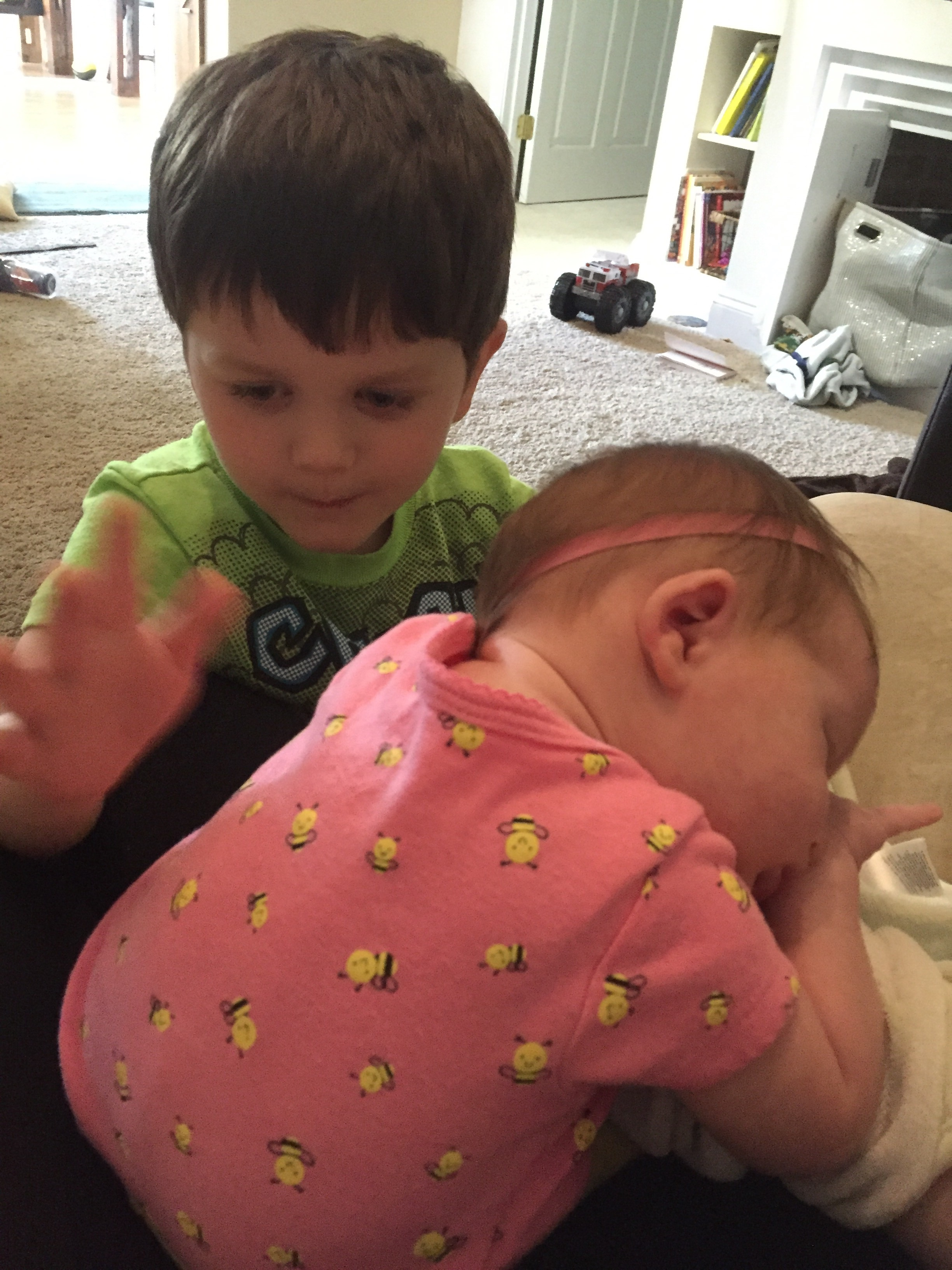 Big brother provides burping help