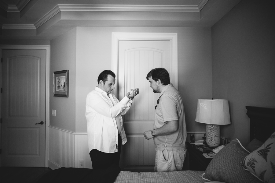 black and white groom getting ready