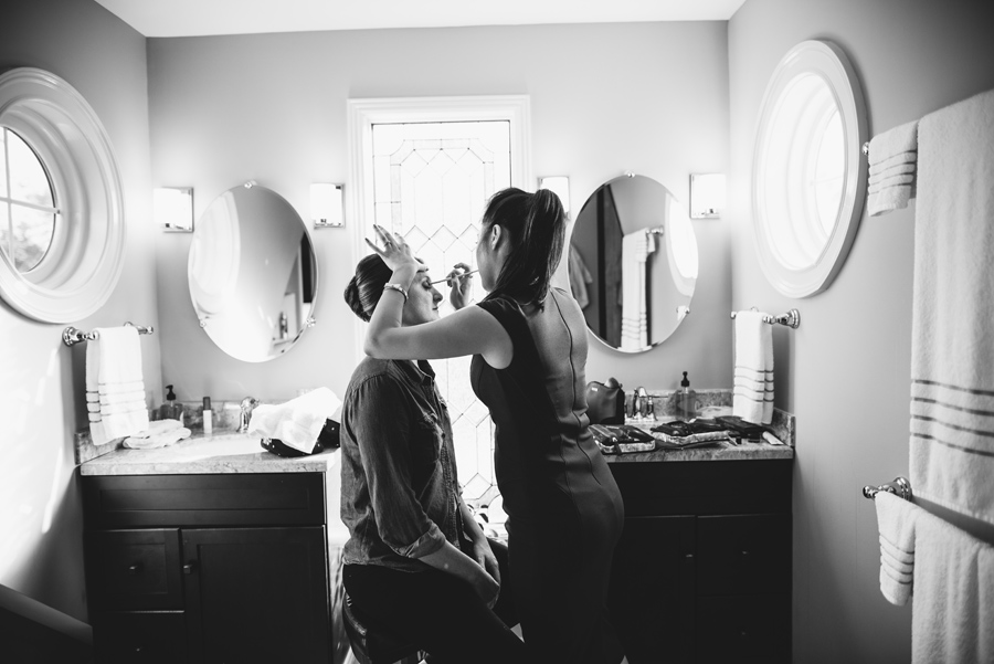 bride getting ready black and white