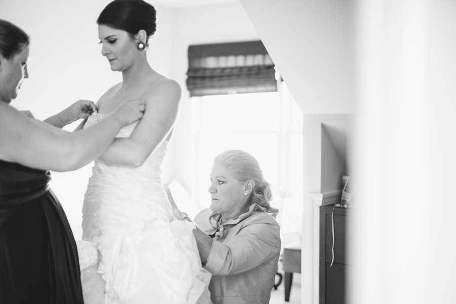 black and white bride getting dressed