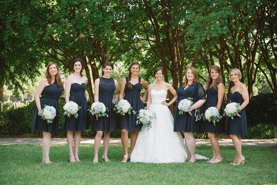 bridesmaids navy dress white flowers