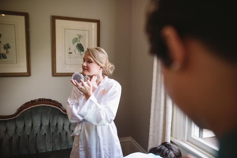 bride makeup in mirror