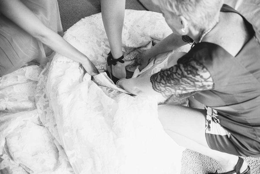 bride stepping into dress