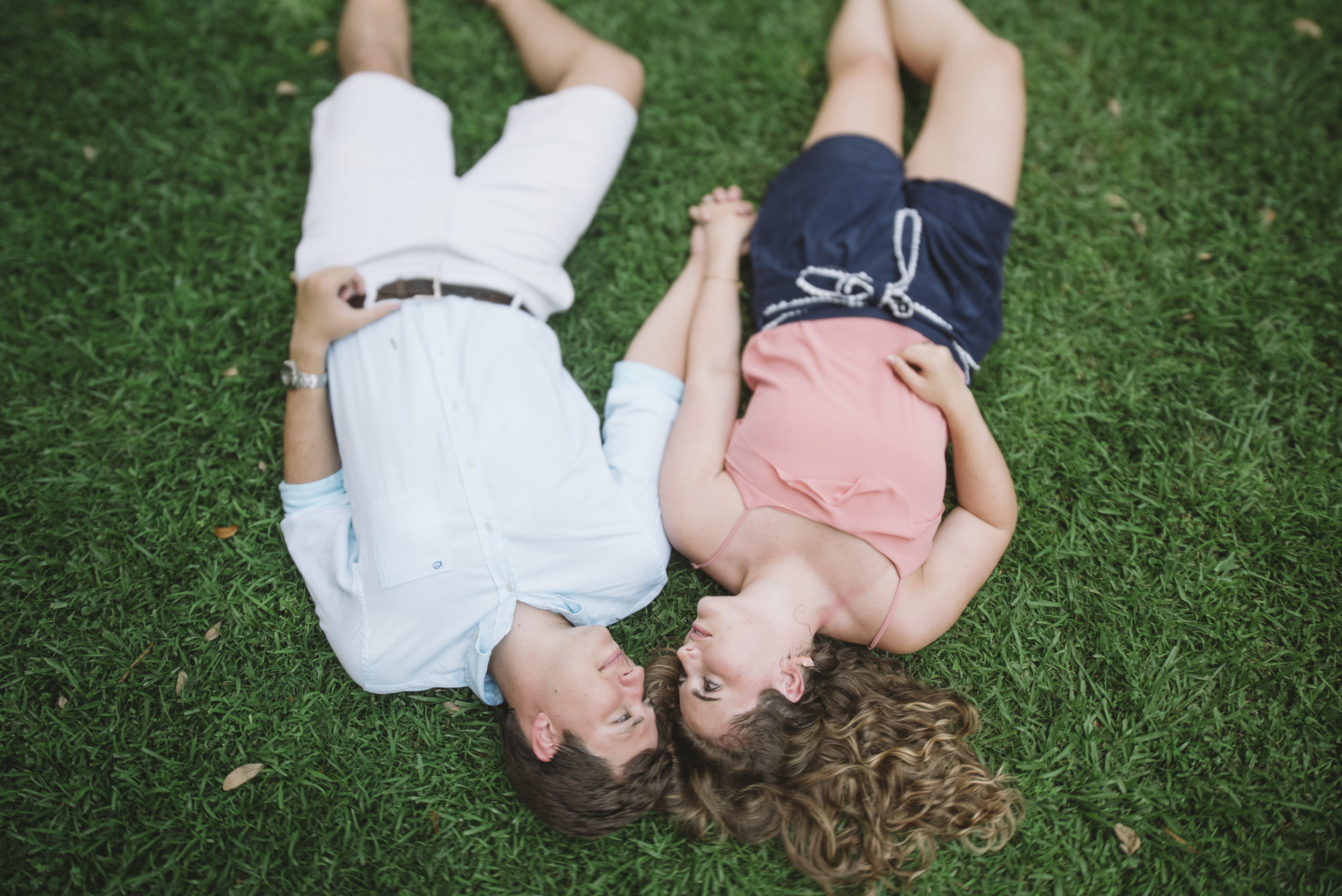 cute engagements in the grass