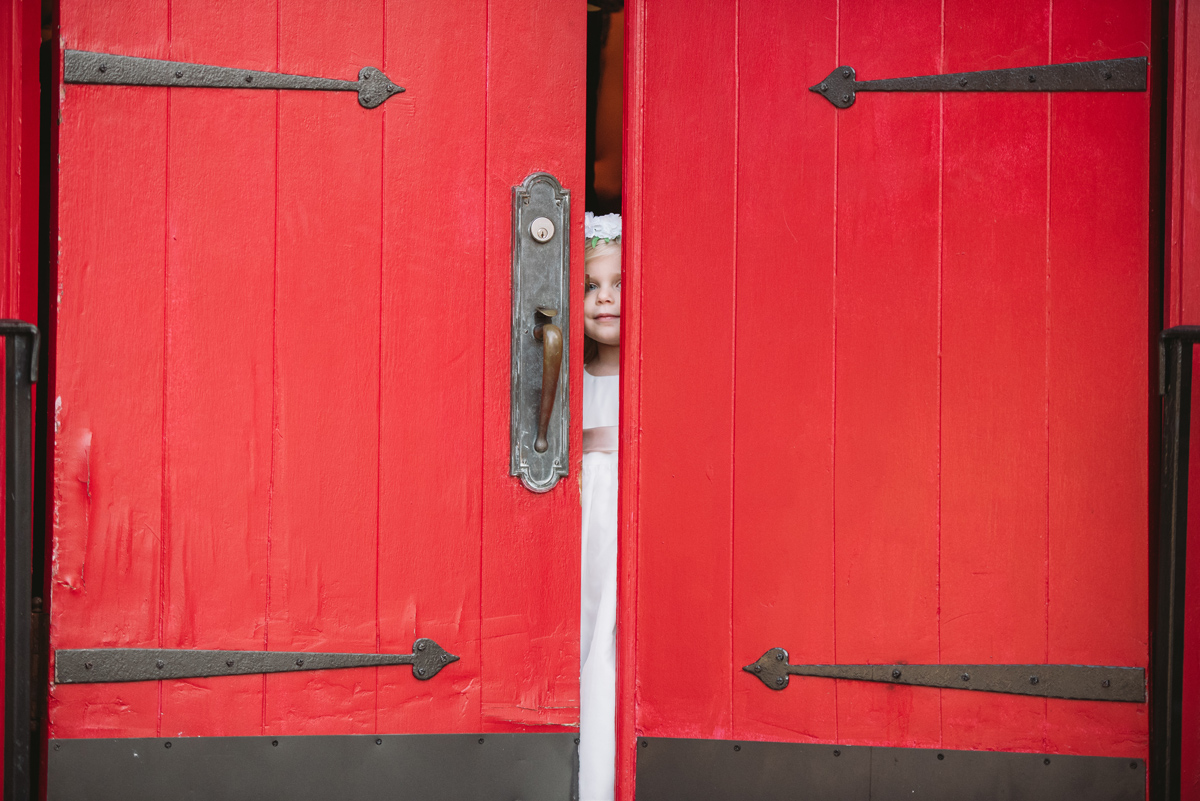 flower girl peeking out door