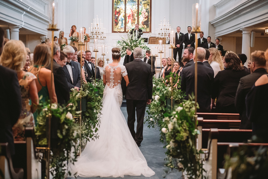 stunning bride walks down aisle