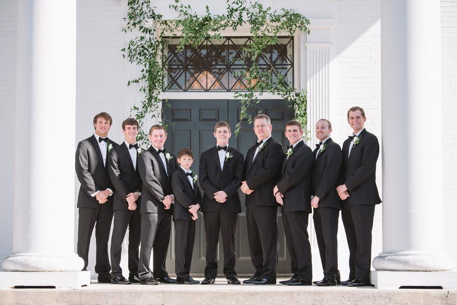 groomsmen in front of church