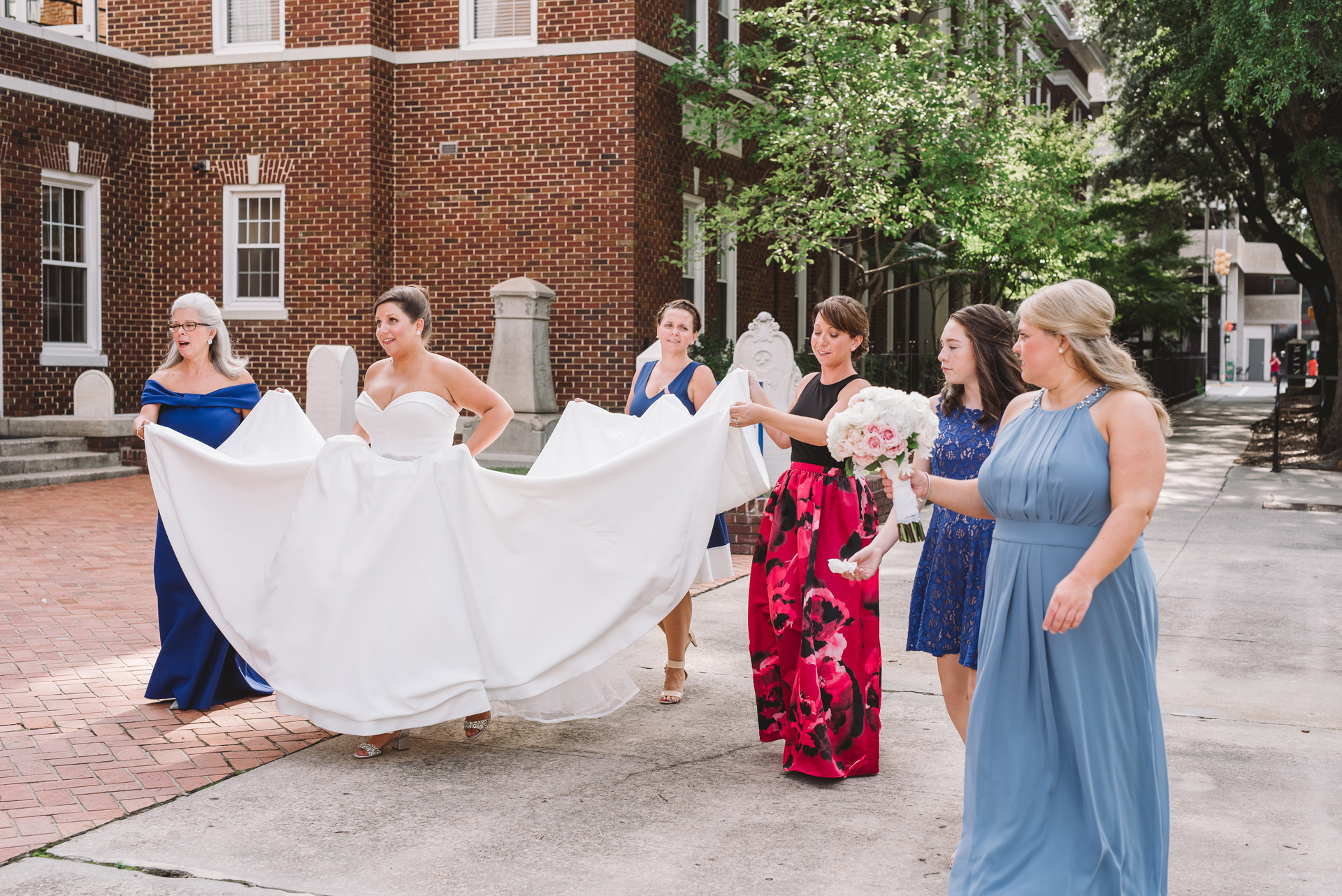 bridesmaids carrying train