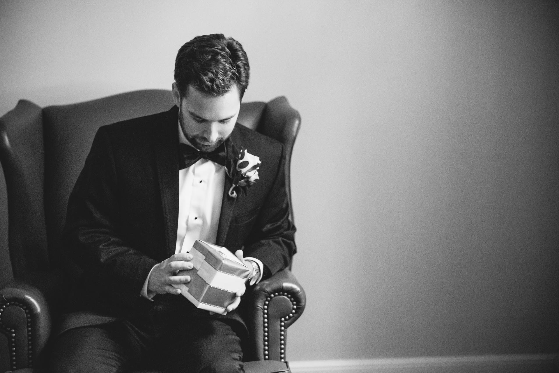 groom opening gift