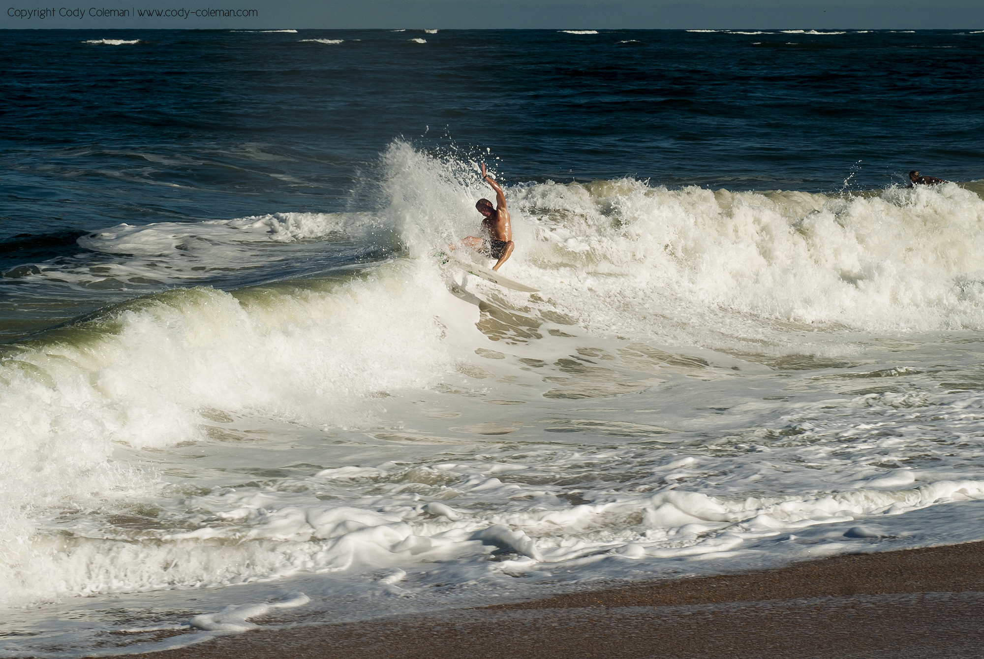 Andrew Gregorie testing the durability of his fins.