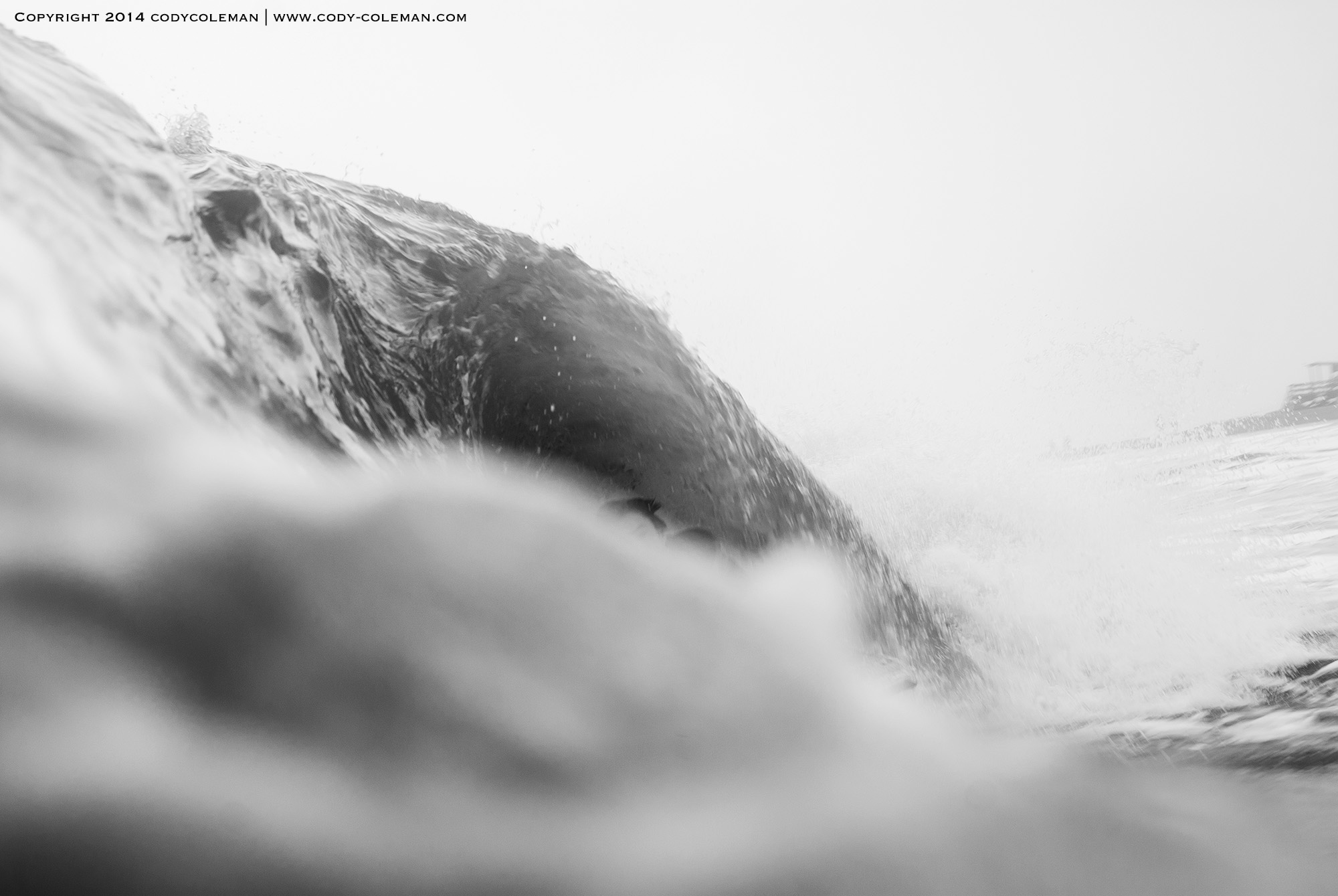 Jared Jeffs in the tube and behind the wave.