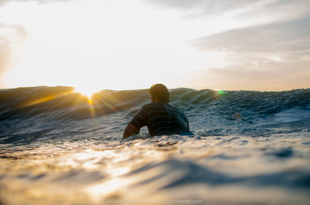 Franshot Barba soaking the the first bits of sunlight on his paddle out Wednesday morning.