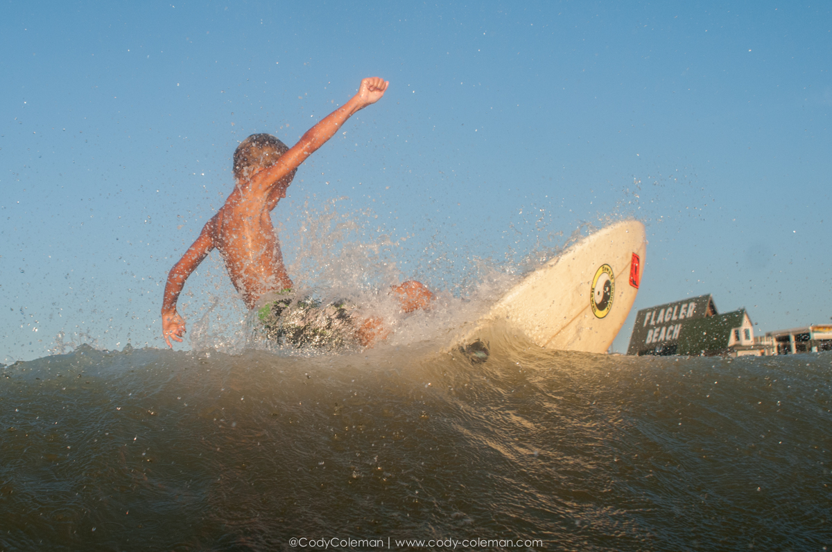 The next generation of surfer snapping right into a Flagler beach surf Ad.