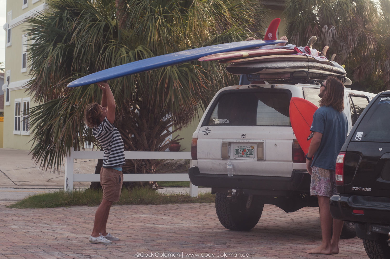 Left is contest winner Saxon Wilson ( @saxon_wilson ) just after sunrise stacking boards on Conklin's truck to drive on the beach.