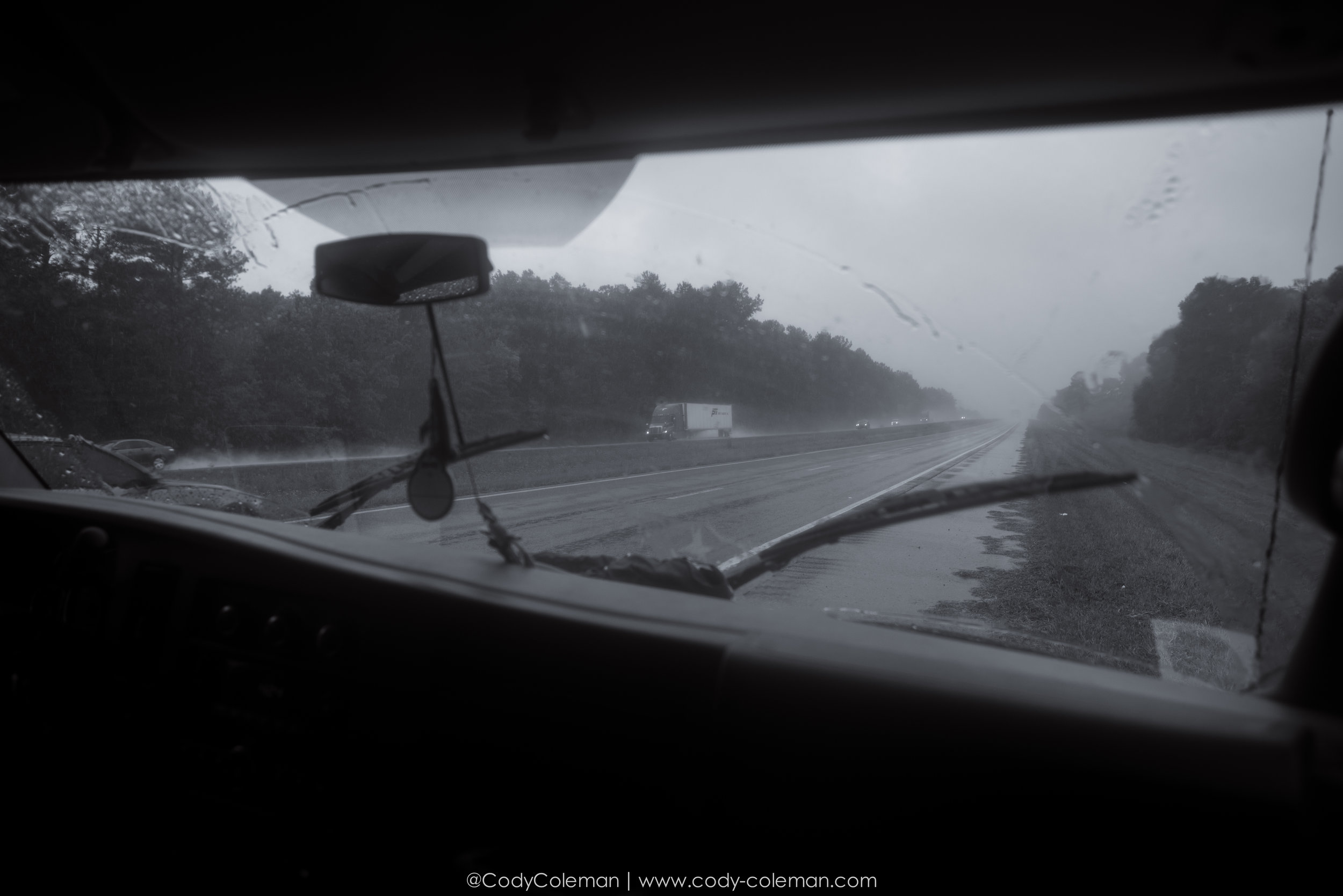 With the center of Tropical Storm Cindy nearing the coast line the weather conditions slowly deteriorated the further we drove west... This photos was actually taken during a pit stop on the side of Interstate 10 west. Only stop we made the whole trip while driving...