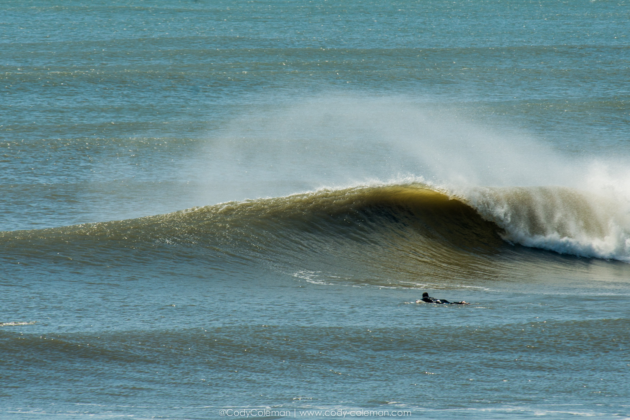 Its been long time since I have shot land photos, but with a large swell breaking on the outside I felt the morning session was best viewed from this vantage point.