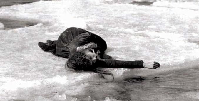 Lilian Gish lays on ice.
